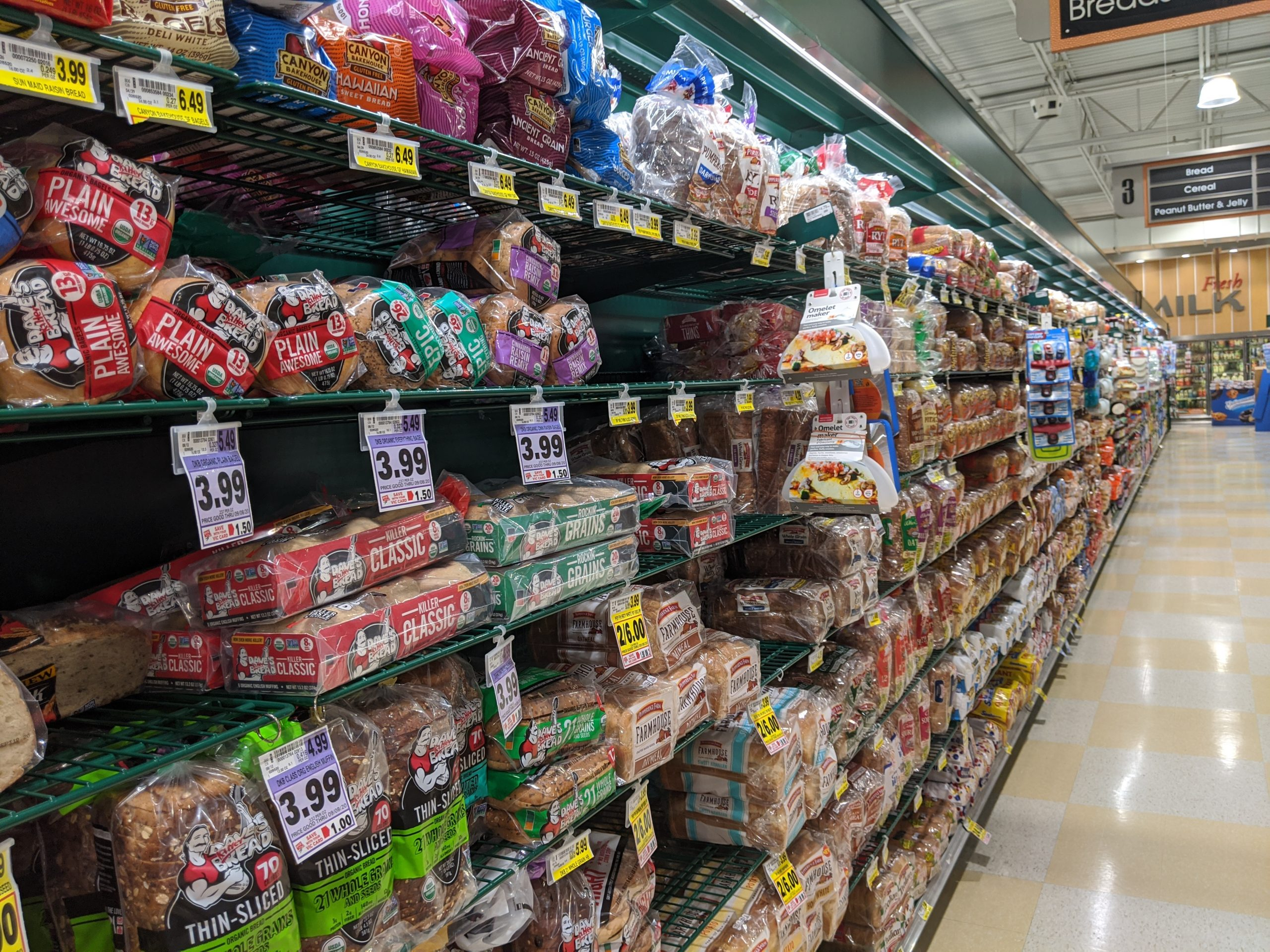 picture of harris teeter bread aisle showing the overwhelming amount of bread options