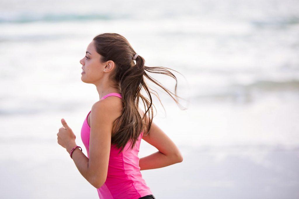 girl running in pink tank top